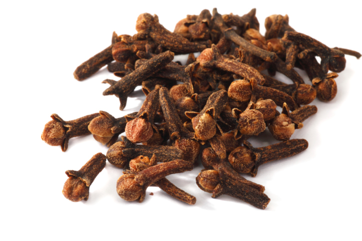 Spices closeup. Cloves dried on white background. Soft shadow